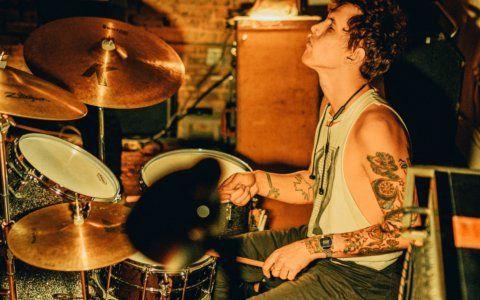 Drummer playing funk drum beats